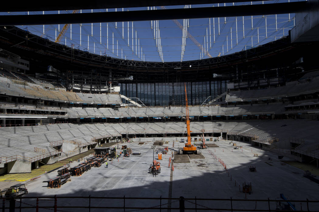 Construction crews on the field level of the the Raiders Allegiant Stadium in Las Vegas, Tuesda ...