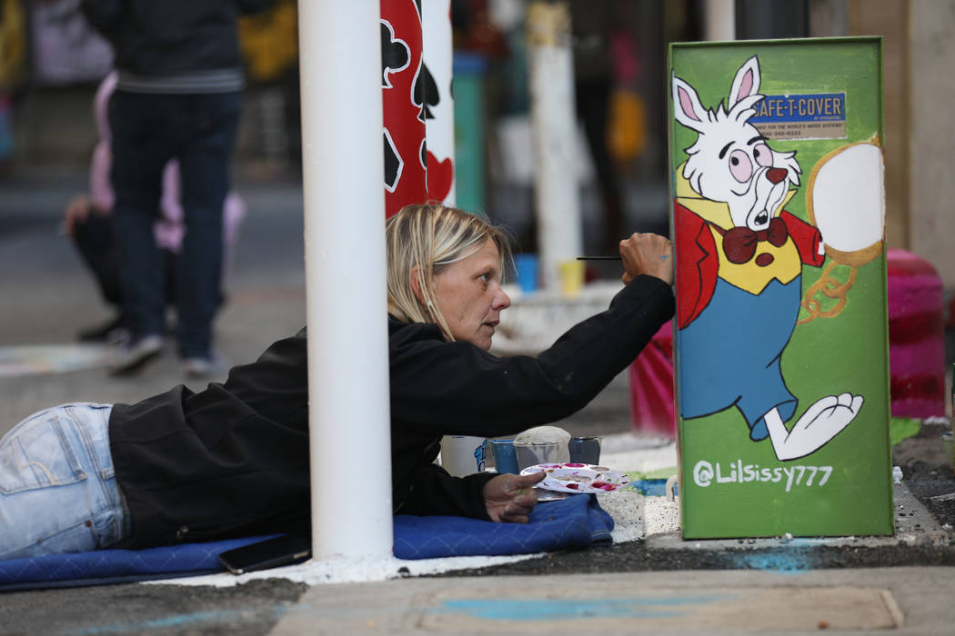 Local muralist Sissy Murphy paints during the grand opening dT-Alley in downtown Las Vegas on T ...