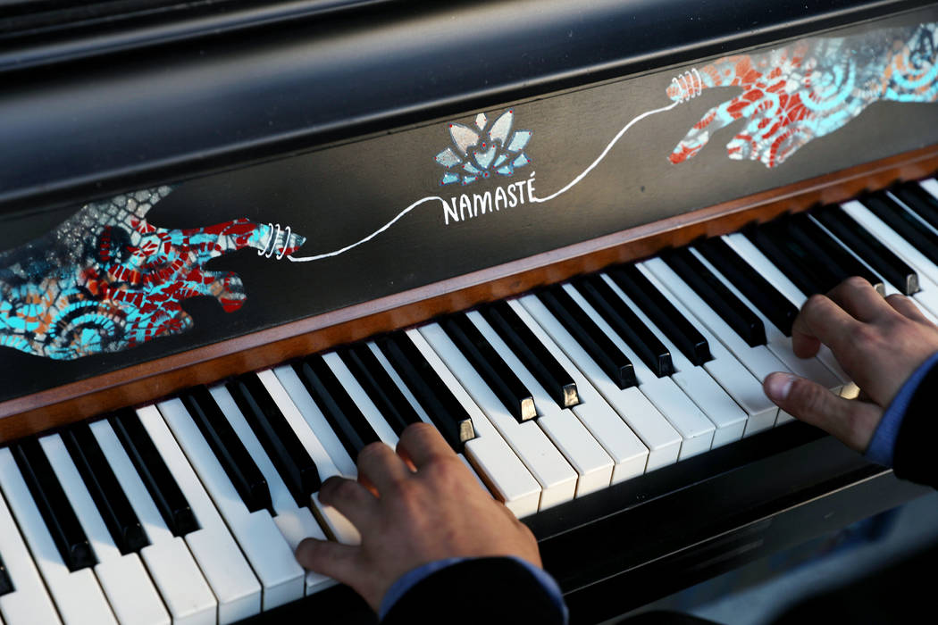 Jules Kessler, 14, plays a donated piano during the grand opening of dT-Alley in Las Vegas on ...