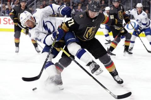 Tampa Bay Lightning defenseman Kevin Shattenkirk (22) and Vegas Golden Knights center William K ...