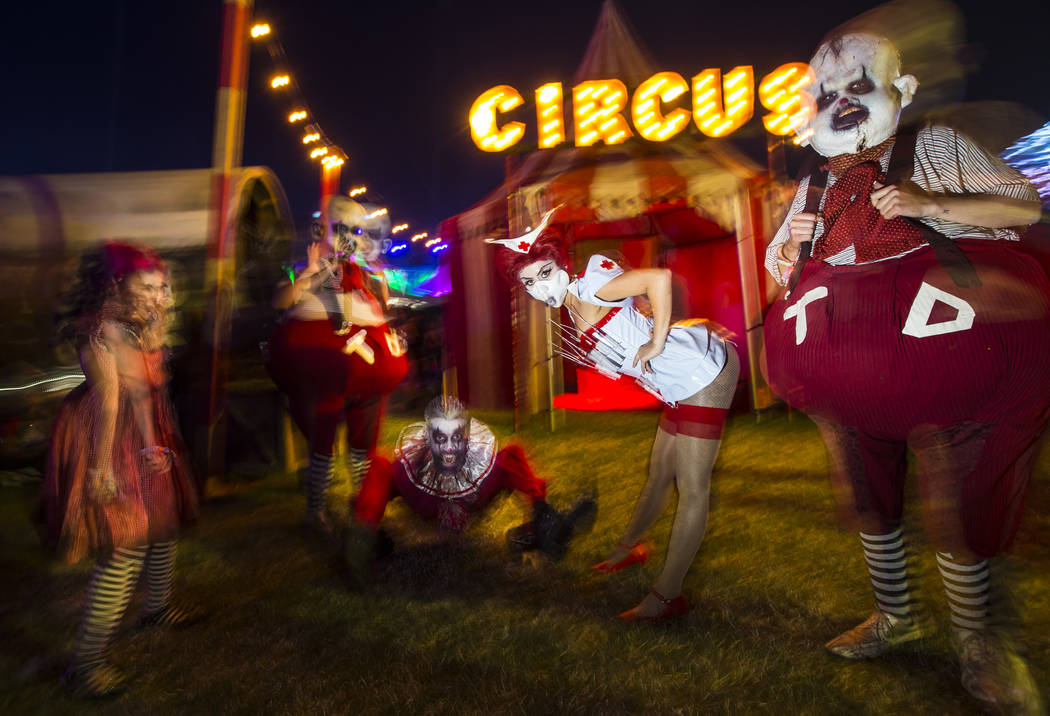 Costumed characters pose during the first day of the Electric Daisy Carnival at the Las Vegas M ...