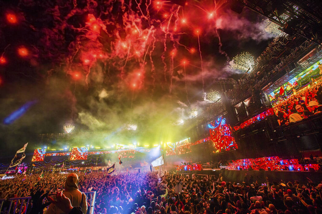 Fireworks light up the sky during Steve Aoki's performance at the Circuit Grounds stage on day ...
