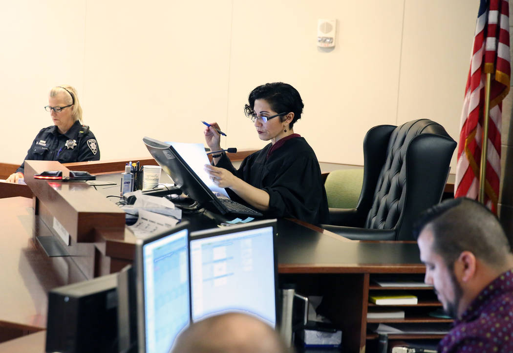 Judge Holly Stoberski, center, preside over the initial appearance of suspects at the Regional ...
