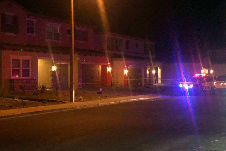 Police investigate a shooting in the 5900 block of Yellow Ridge Avenue in Las Vegas on Thursday ...