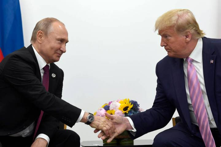 In this June 28, 2019, file photo, President Donald Trump, right, shakes hands with Russian Pre ...