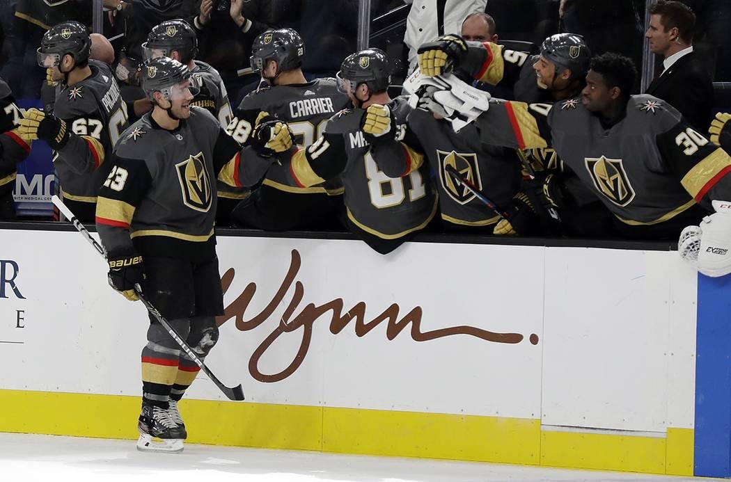Vegas Golden Knights defenseman Alec Martinez (23) celebrates after scoring against the Tampa B ...