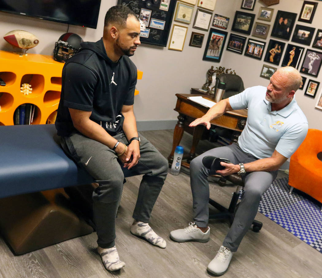 Sports Injury Specialist and Performance Coach Tobe Hanson, right, works with Stanford Universi ...