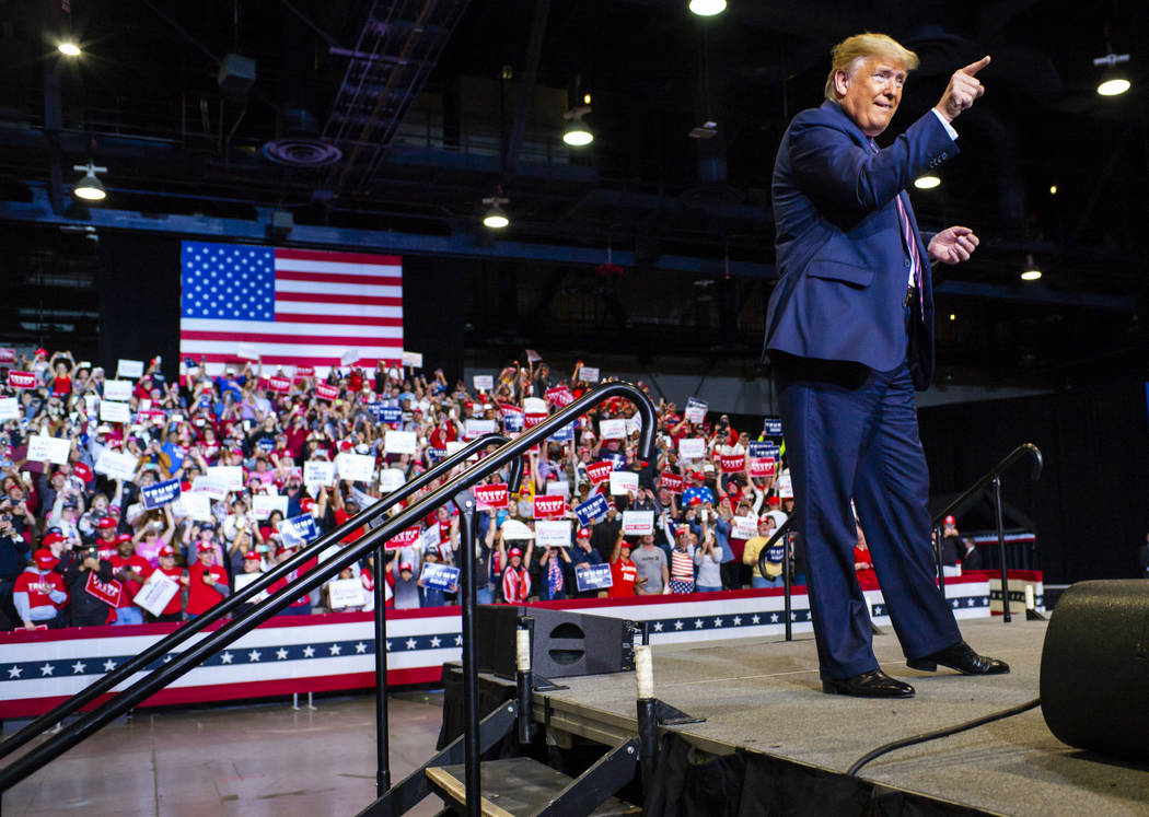 President Donald Trump arrives for a rally at the Las Vegas Convention Center in Las Vegas on F ...