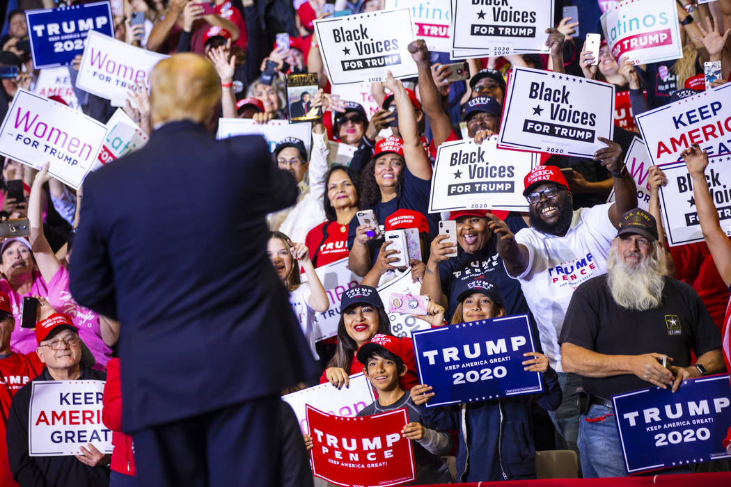 Supporters cheer as President Donald Trump arrives for a rally at the Las Vegas Convention Cent ...