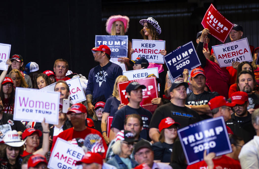 Supporters of President Donald Trump cheer before his arrival at a rally at the Las Vegas Conve ...