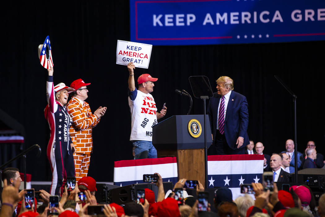 President Donald Trump welcomes supporters to the stage during a rally at the Las Vegas Convent ...
