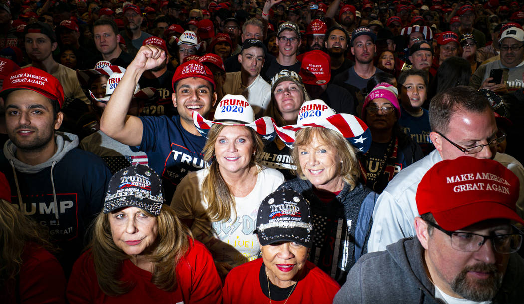 Supporters of President Donald Trump, not pictured, listen as Vice President Mike Pence speaks ...