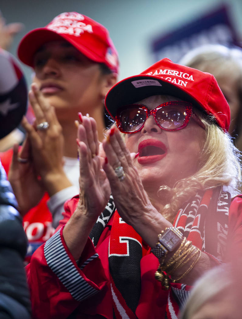 Supporters of President Donald Trump, not pictured, cheer as Vice President Mike Pence speaks a ...