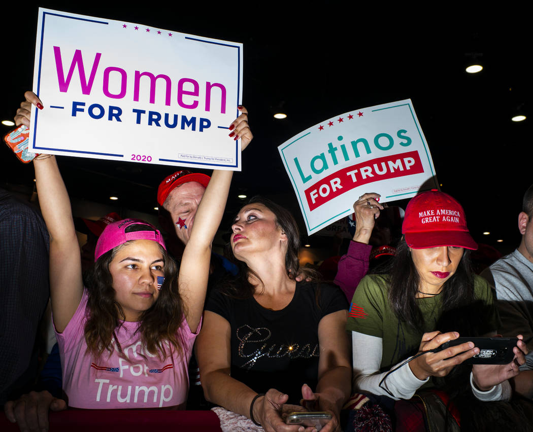 Supporters of President Donald Trump, not pictured, cheer before his arrival at a rally at the ...