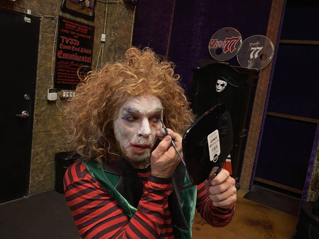 """Carrot Top is shown touching up his makeup before recording a heavy metal version of """"Send In T ..."""