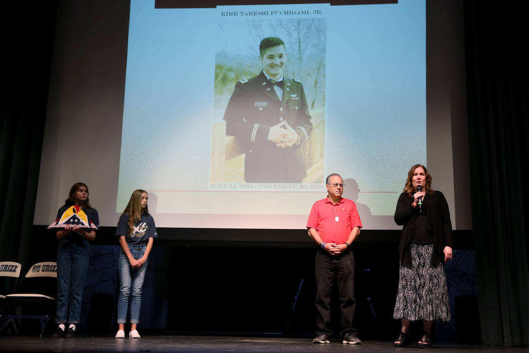 Lisa Casey, far right, mother of fallen U.S. Army Chief Warrant Officer Kirk T. Fuchigami, spea ...