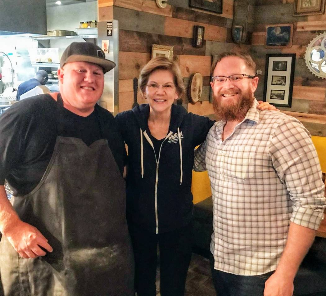 Sen. Elizabeth Warren is shown with Esther's Kitchen chef/owner James Trees, left, and GM Dylan ...