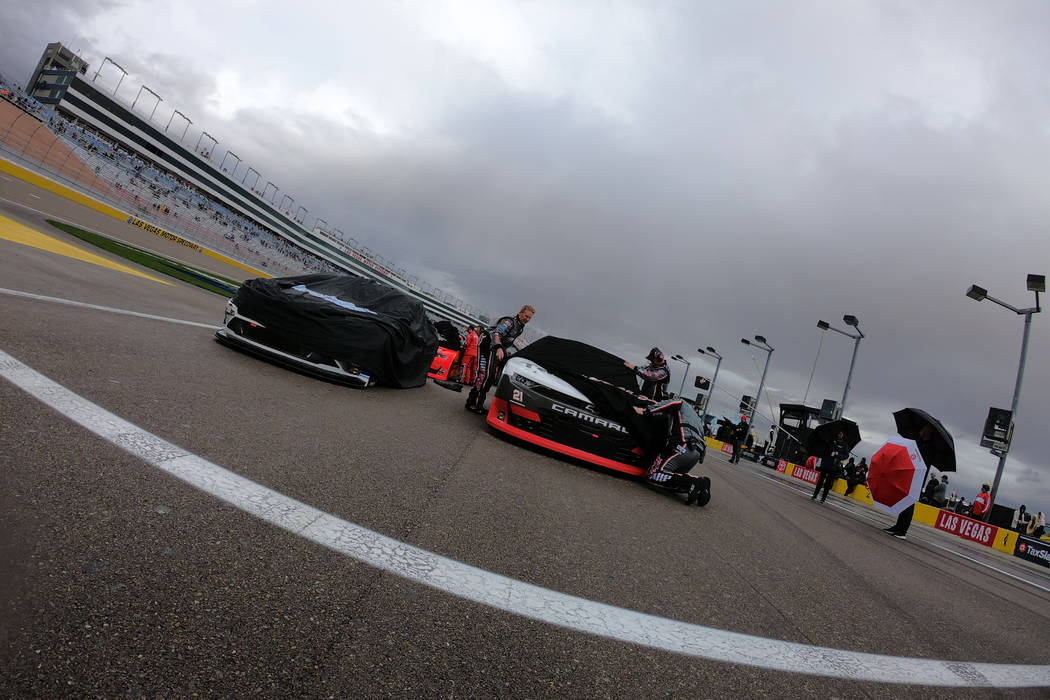 LAS VEGAS, NV - FEBRUARY 22: Cars are covered for rain during a rain delay before the start of ...