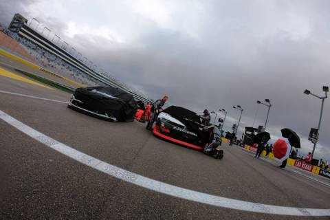 Cars are covered for rain during a rain delay before the start of NASCAR Xfinity Series Boyd Ga ...