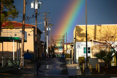 A rainbow rises above Maryland Parkway after rain in downtown Las Vegas on Saturday, Feb. 22, 2 ...