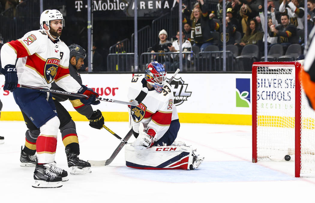 Golden Knights' Tomas Nosek, not pictured, sends the puck past Florida Panthers goaltender Sam ...