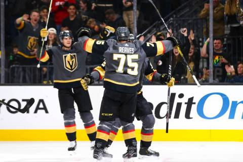 Golden Knights players celebrate a goal by Tomas Nosek during the first period of an NHL hockey ...