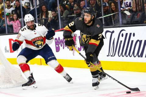 Golden Knights' Gage Quinney (72) sends the puck past Florida Panthers' Aaron Ekblad (5) during ...