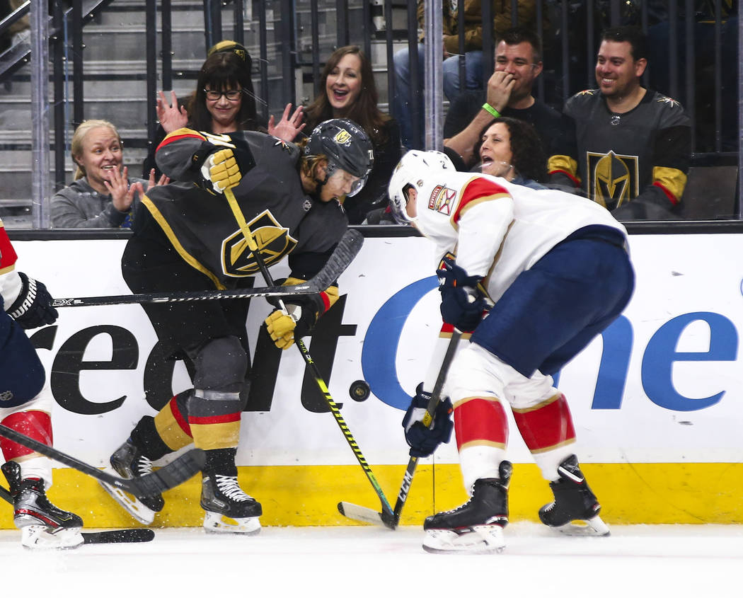 Golden Knights' William Karlsson (71) battles for the puck against Florida Panthers' Josh Brown ...