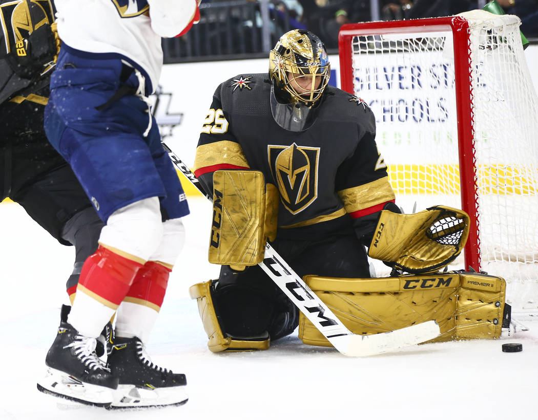 Golden Knights goaltender Marc-Andre Fleury (29) stops the puck from the Florida Panthers durin ...
