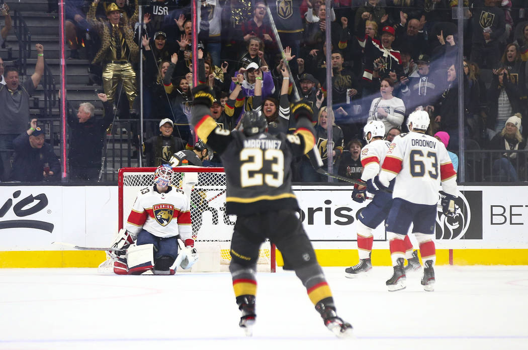 Golden Knights' Alec Martinez (23) celebrates a goal by teammate Max Pacioretty, not pictured, ...