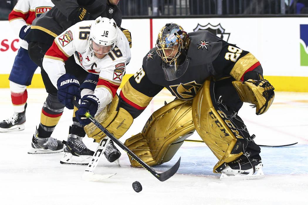 Golden Knights goaltender Marc-Andre Fleury (29) stops Florida Panthers' Aleksander Barkov (16) ...
