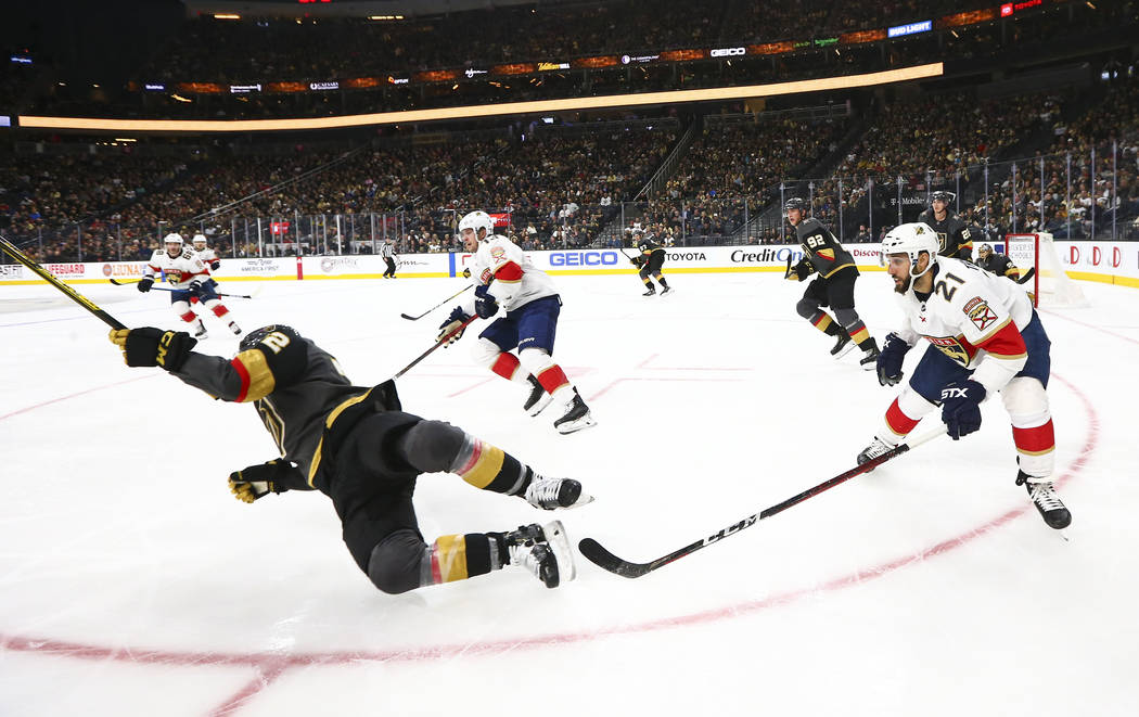 Golden Knights' Gage Quinney (72) gets tripped by Florida Panthers' Vincent Trocheck (21) durin ...
