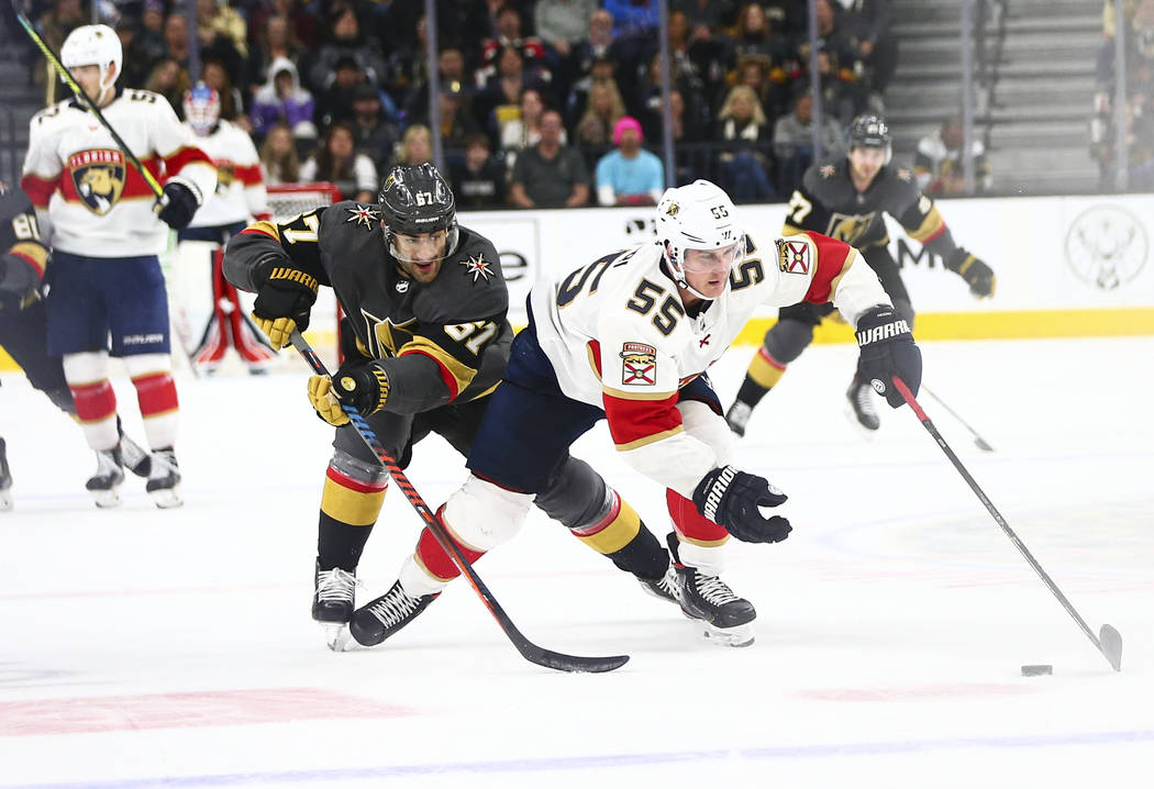 Florida Panthers' Noel Acciari (55) skates with the puck as Golden Knights' Max Pacioretty (67) ...
