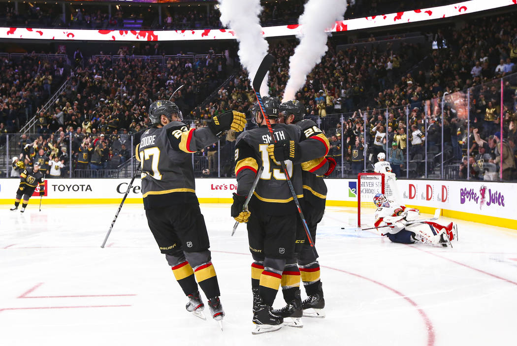 Golden Knights' Reilly Smith (19) celebrates with teammates after scoring past Florida Panthers ...