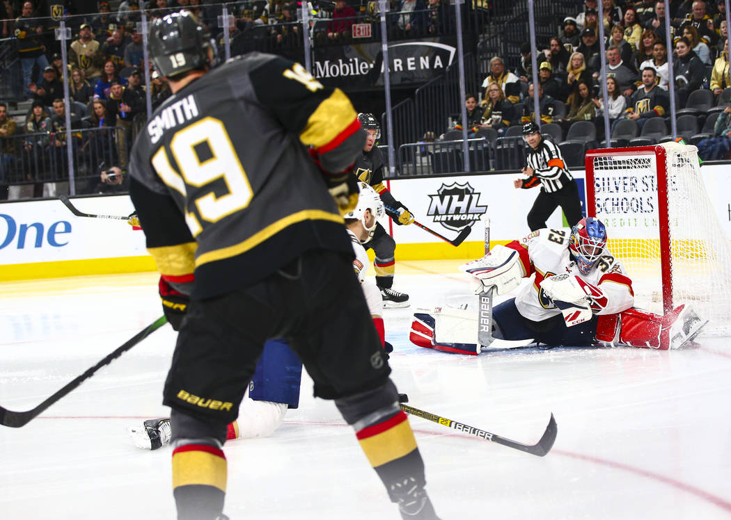 Golden Knights' Reilly Smith (19) shoots to score past Florida Panthers goaltender Sam Montembe ...
