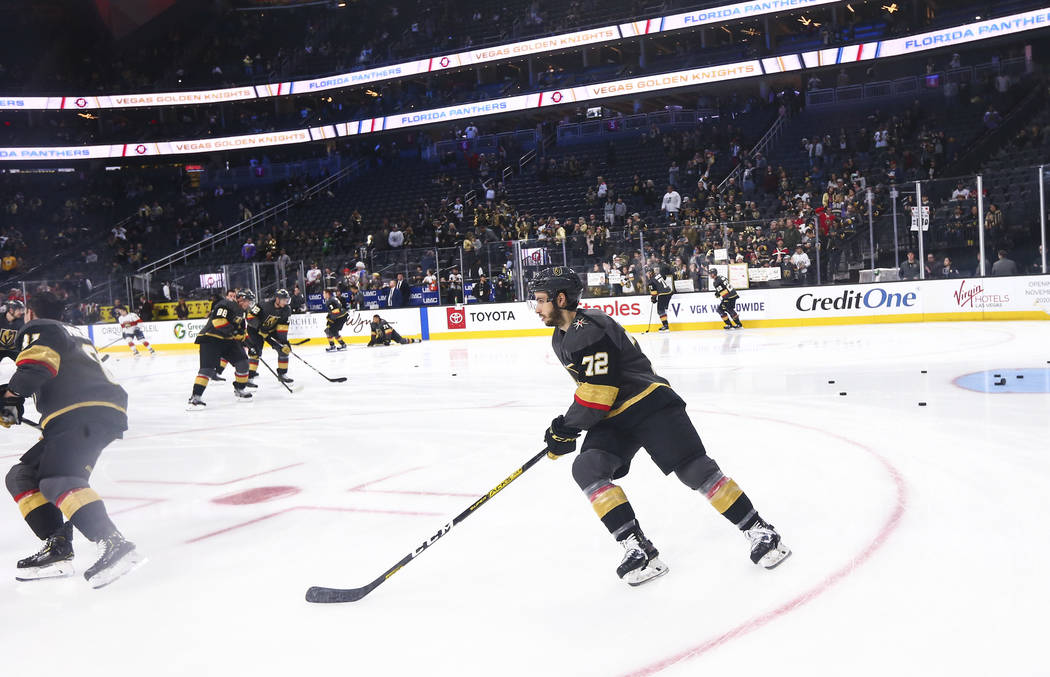 Golden Knights' Gage Quinney (72) skates on the ice while warming up before an NHL hockey game ...