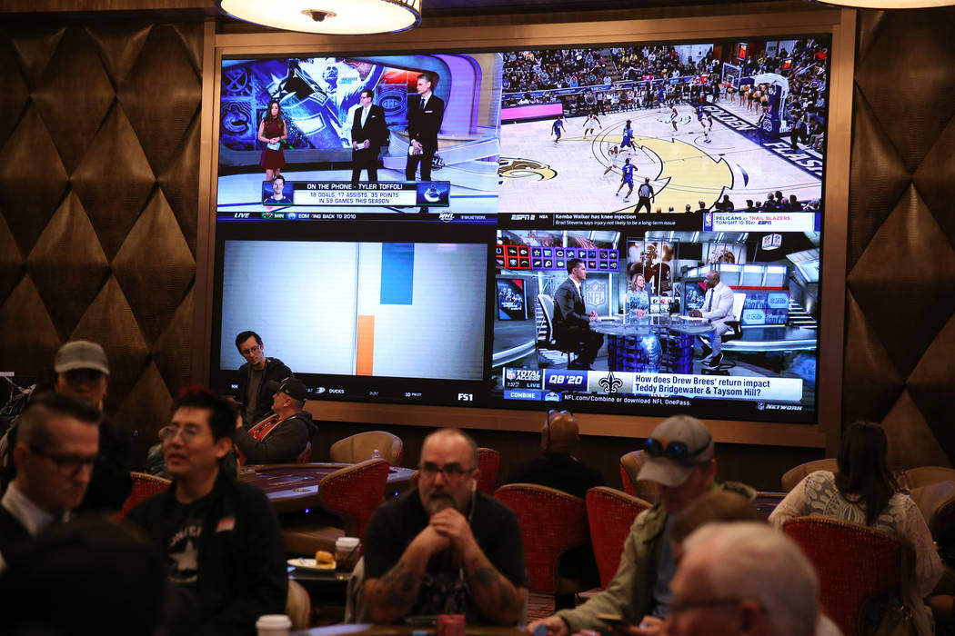 Televisions on the wall of the new poker room at Sahara Las Vegas casino-hotel in Las Vegas, Fr ...