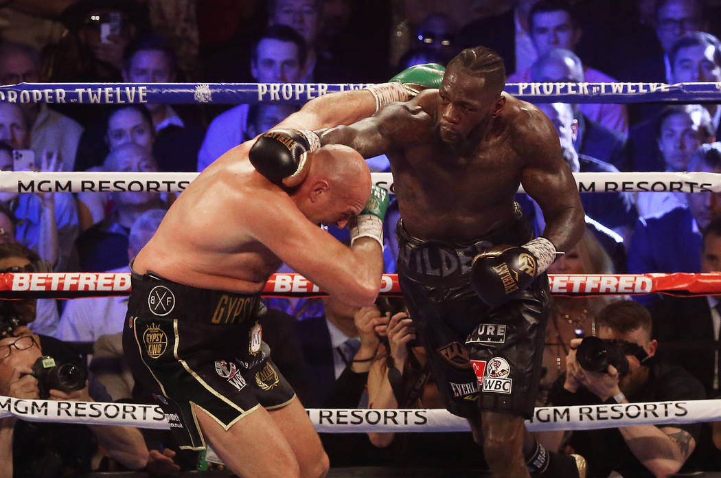 Deontay Wilder, right, connects with a right hook against Tyson Fury in the fourth round during ...