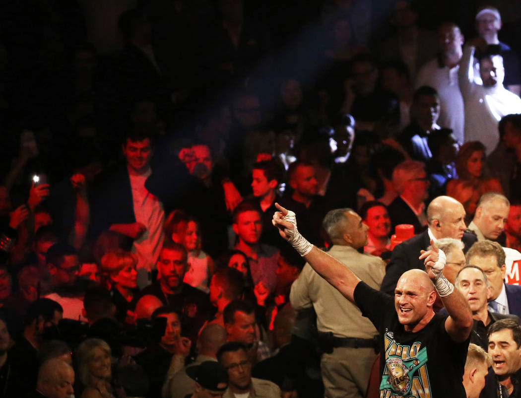 Tyson Fury, bottom/right, celebrates after beating Deontay Wilder in the seventh round during t ...