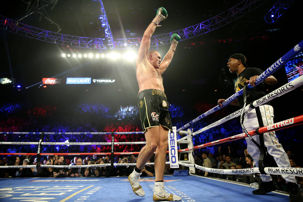 Tyson Fury reacts to his technical knockout win against Deontay Wilder in round 7 of the WBC wo ...