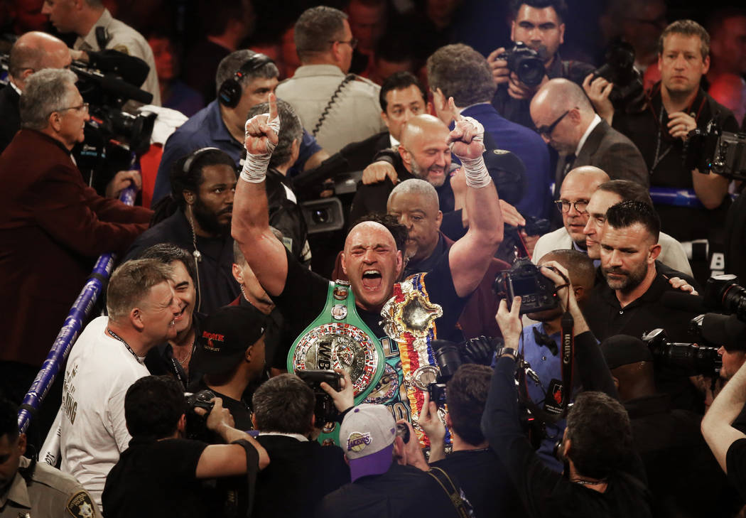 Tyson Fury celebrates after beating Deontay Wilder in the seventh round during their WBC heavyw ...