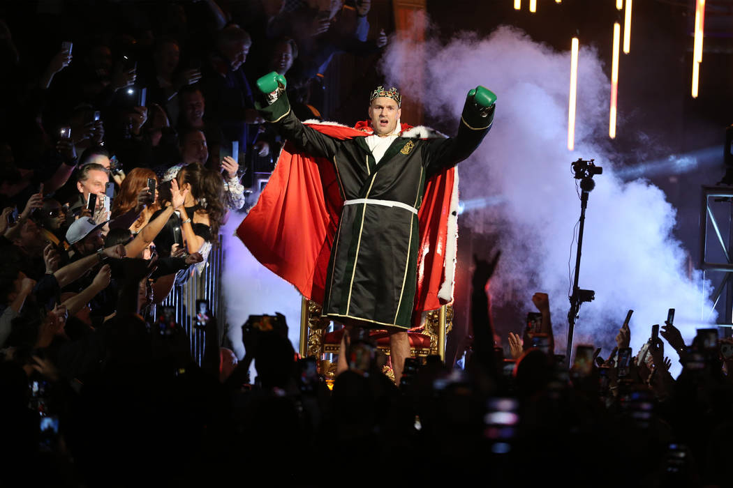 Tyson Fury makes his grand entrance for the WBC world heavyweight championship bout against Deo ...