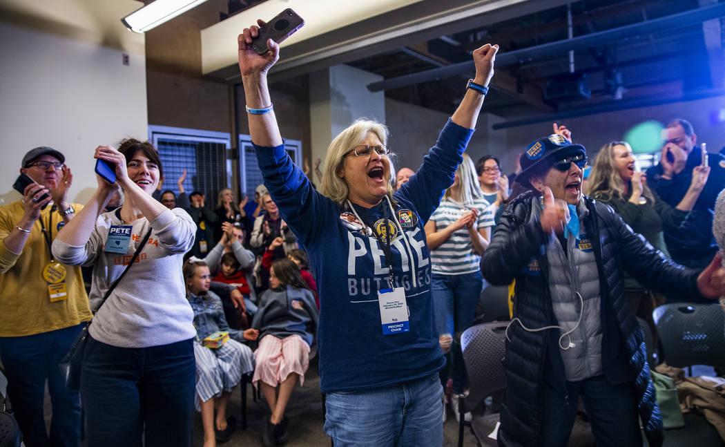 Crowd members cheer as Democratic presidential candidate and former South Bend, Ind., Mayor Pet ...