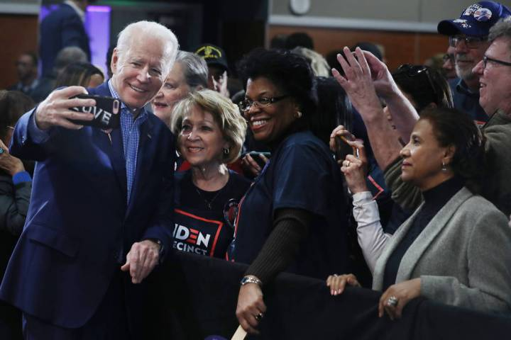 Democratic presidential candidate former Vice President Joe Biden takes photographs with suppor ...