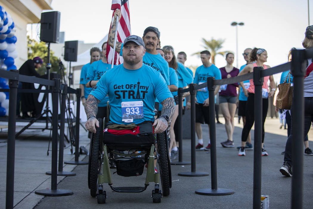 Travis Strong, a double amputee who lost both of his legs in Baghdad, prepares to climb the 1,4 ...