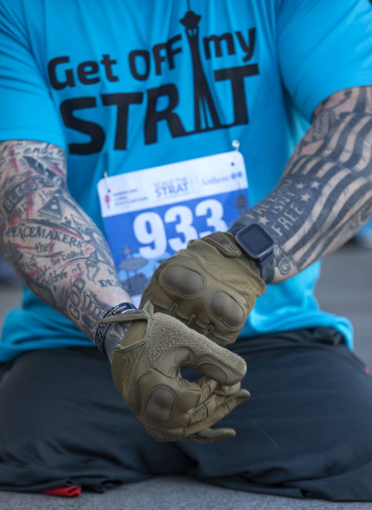 Travis Strong, a double amputee who lost both of his legs in Baghdad, puts on gloves to protect ...