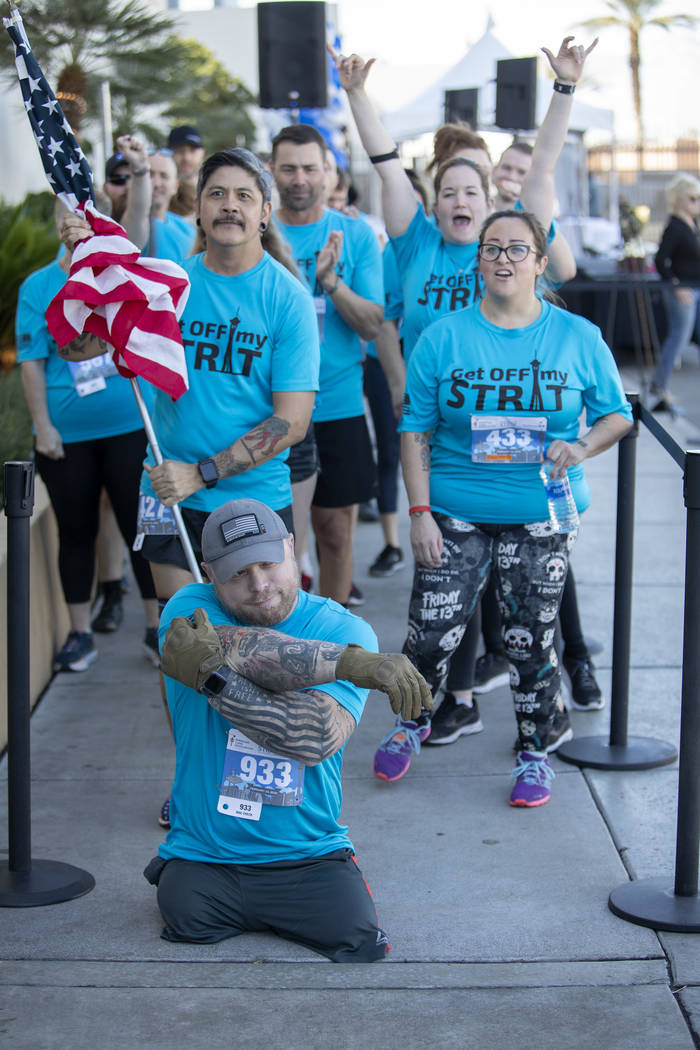 Travis Strong stretches as his teammates cheer behind him at the Strat on Sunday, Feb. 23, 2020 ...