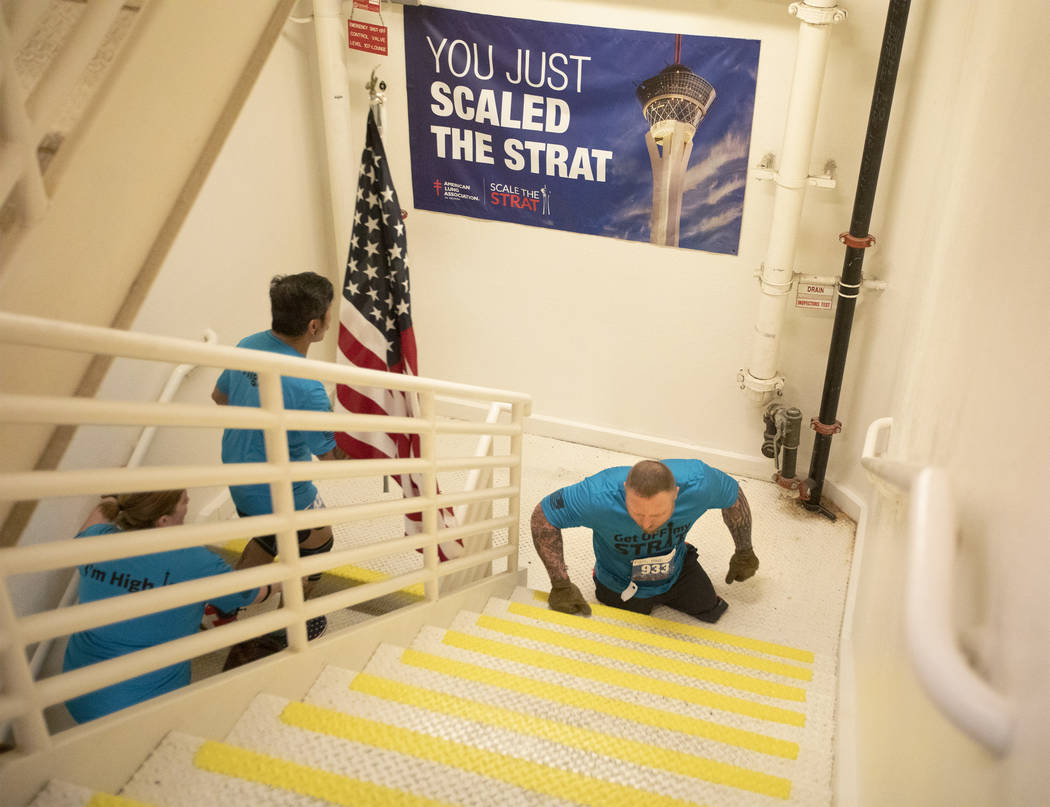 Travis Strong begins to climb the 108th level of stairs at the Strat on Sunday, Feb. 23, 2020, ...