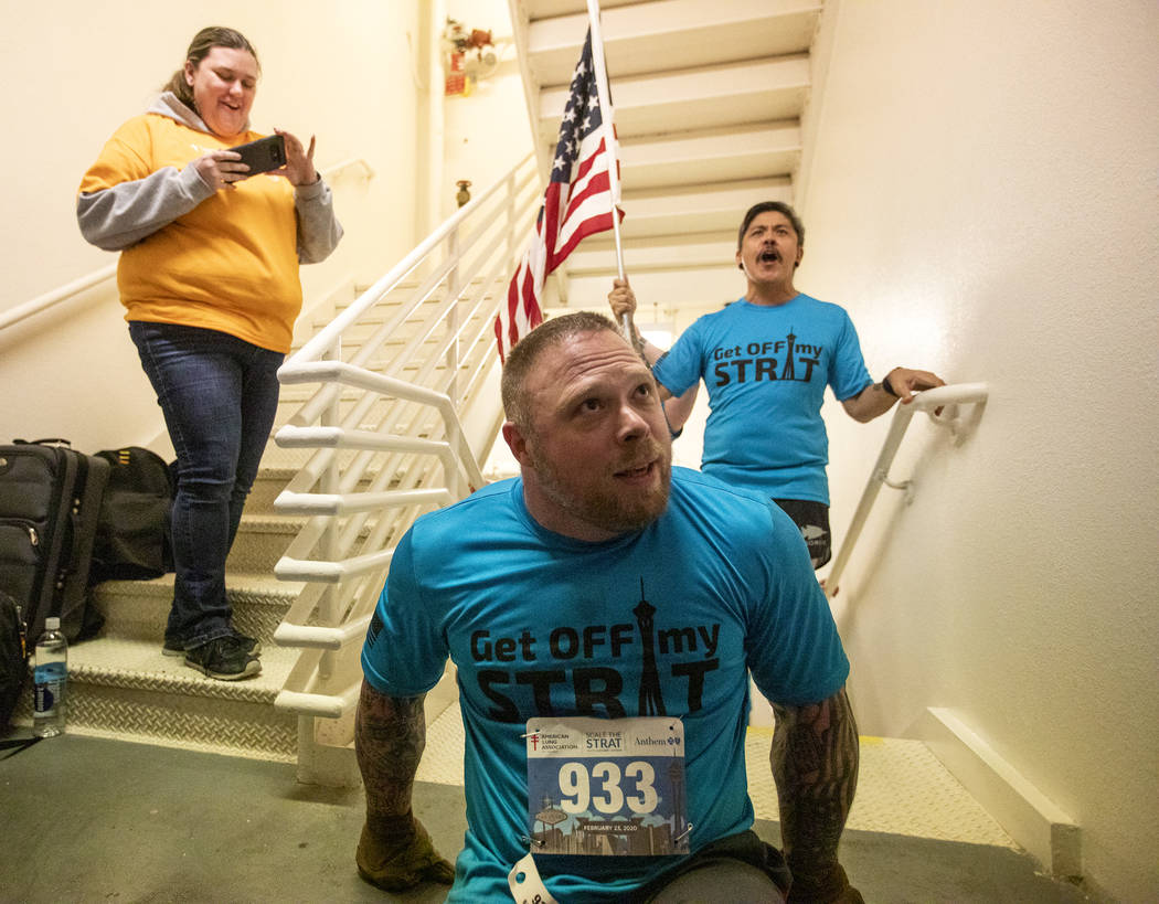 Travis Strong finishes climbing the 108th level of stairs at the Strat on Sunday, Feb. 23, 2020 ...