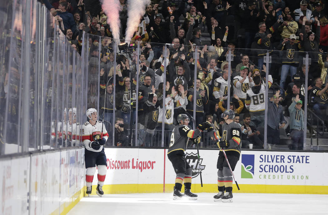 Vegas Golden Knights right wing Reilly Smith (19) celebrates with left wing Tomas Nosek (92) af ...